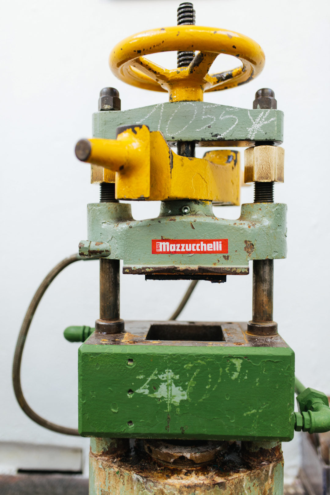 An acetate block casting press inside the Mazzucchelli factory Italy