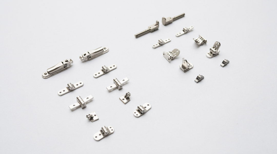 An assortment of metal glasses hinges