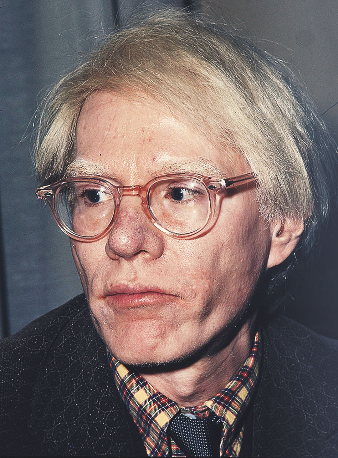 Andy Warhol wearing transparent pink glasses