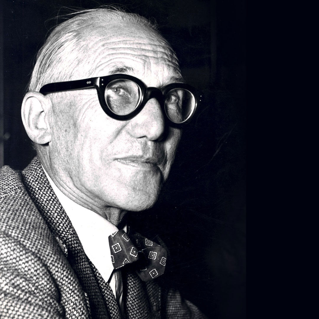 Architect Le Corbusier wearing his thick round glasses frame