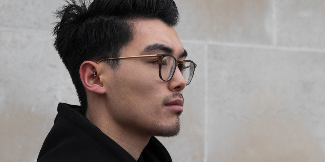 Asian male wearing single vision tortoise spectacles
