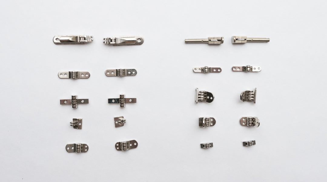 Assortment of different types of glasses hinge parts