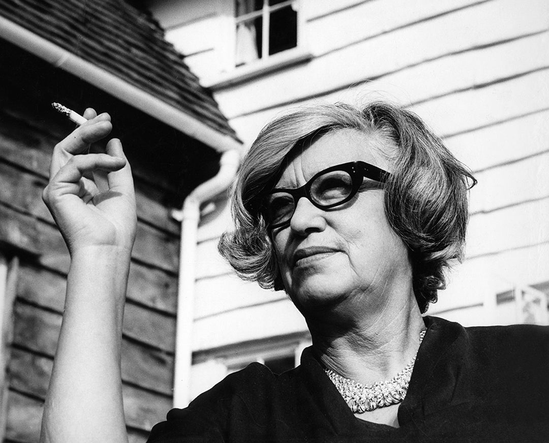 Back and white image of Architect Jane Drew wearing 1960's style thick black glasses