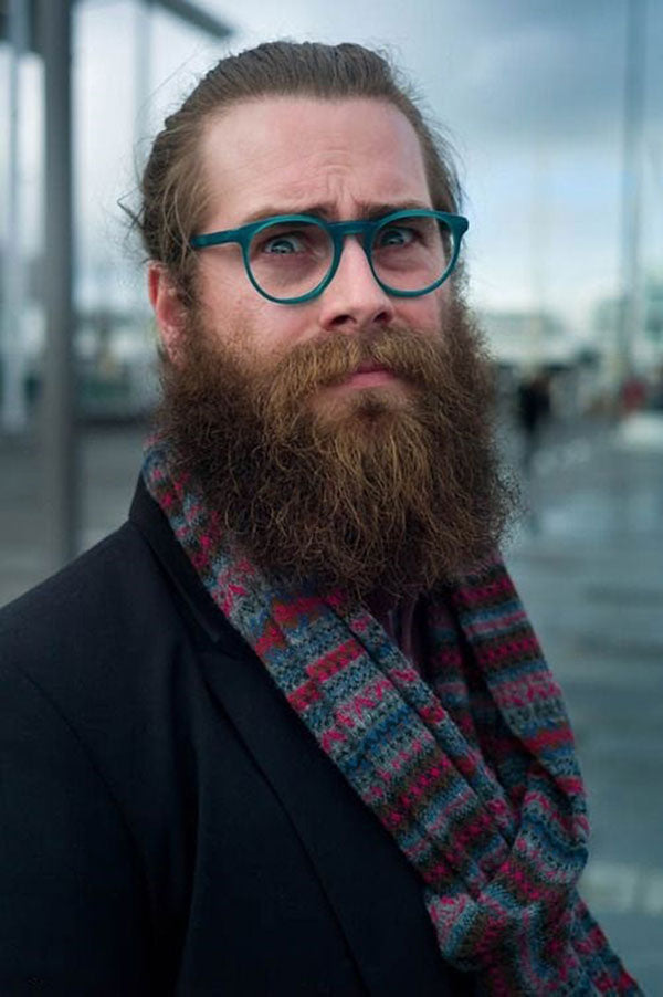 Bearded man wearing turquoise spectacles