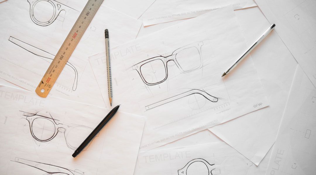 Biro pen drawings of sunglasses frames using a design template ruler and pencil