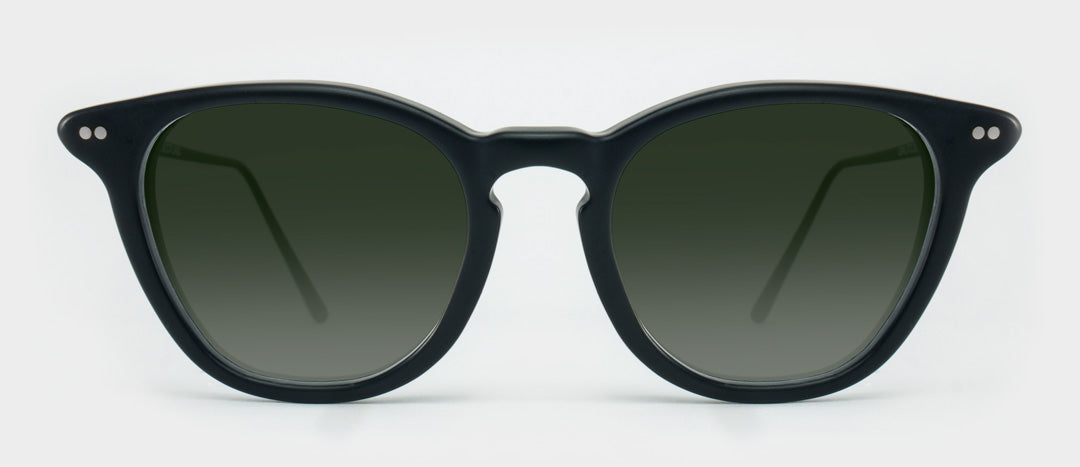 Black sunglasses with green tinted lenses