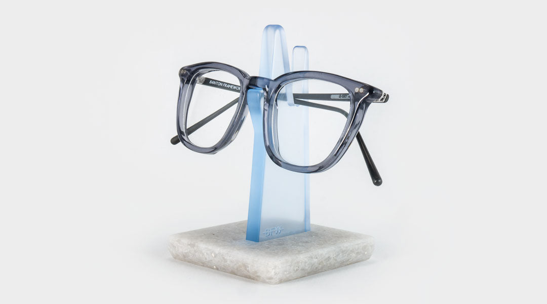 Blue eyeglass holder with grey frame glasses