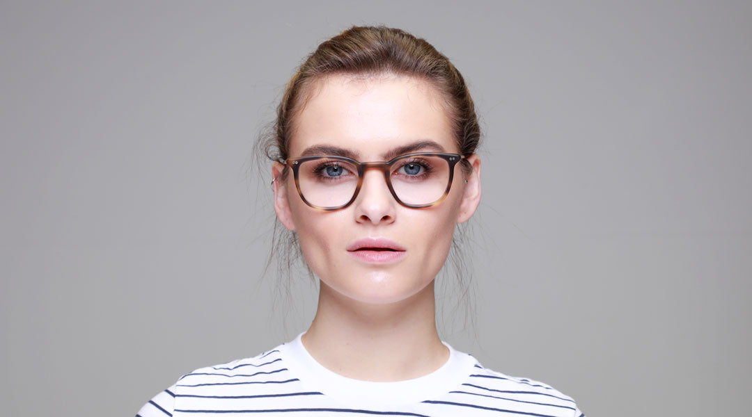 Brunette female wearing tortoise shell spectacles by Banton Frameworks