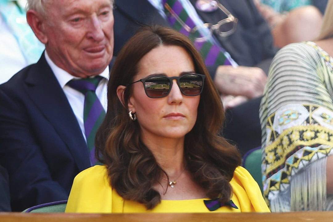 Catherine duchess of cambridge in the royal box at Wimbledon wearing yellow dress and sunglasses