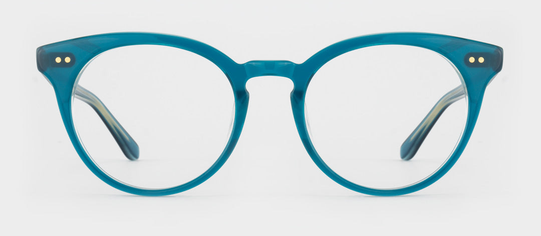 Circular transparent blue spectacle frame with gold rivets