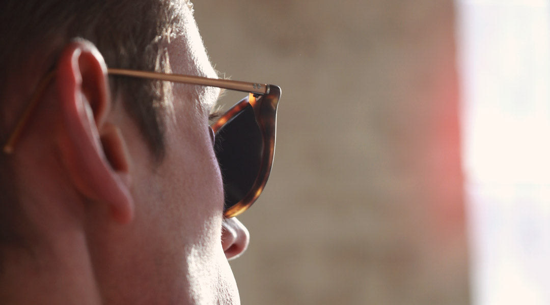 Close side view of man wearing tortoise polarised sunglasses