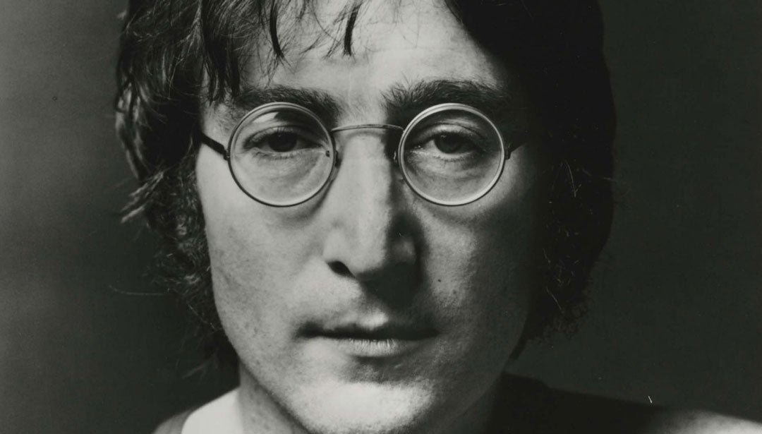 Close view of John Lennon wearing round wire glasses