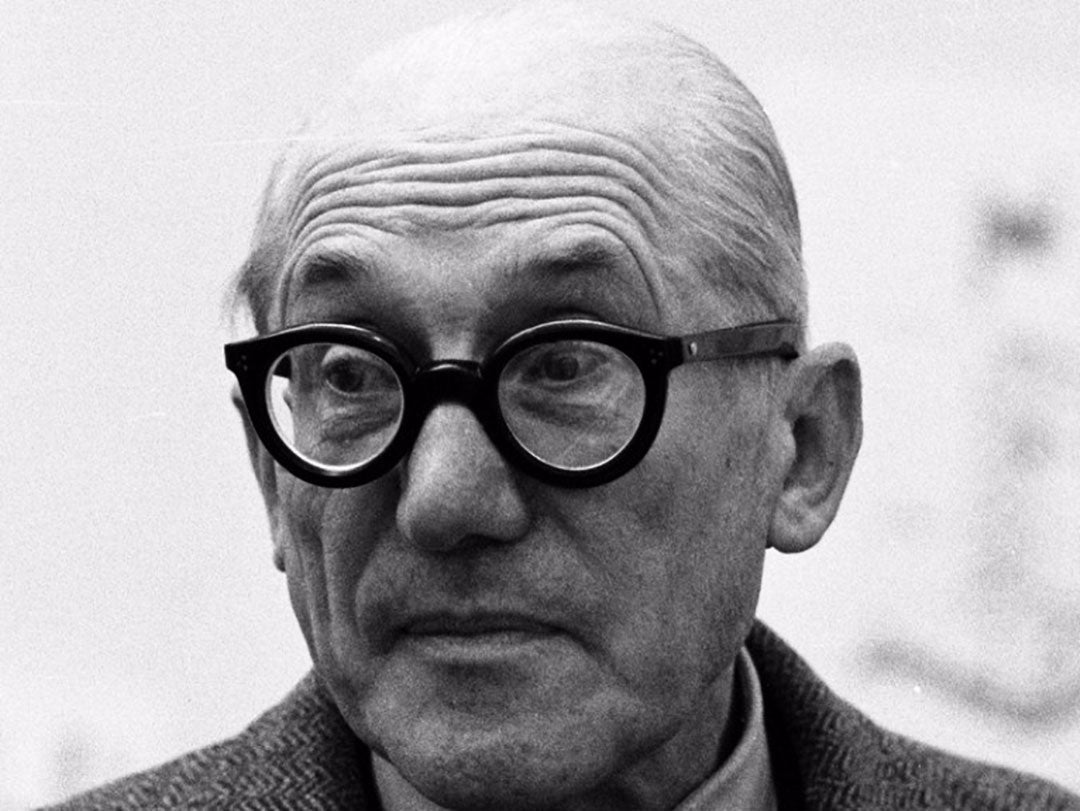 Close view of Swiss architect Le Corbusier wearing thick black spectacles