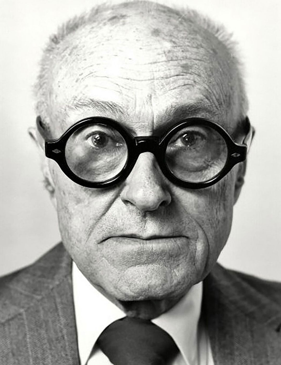 Close view of architect Philip Johnson wearing his thick round glasses