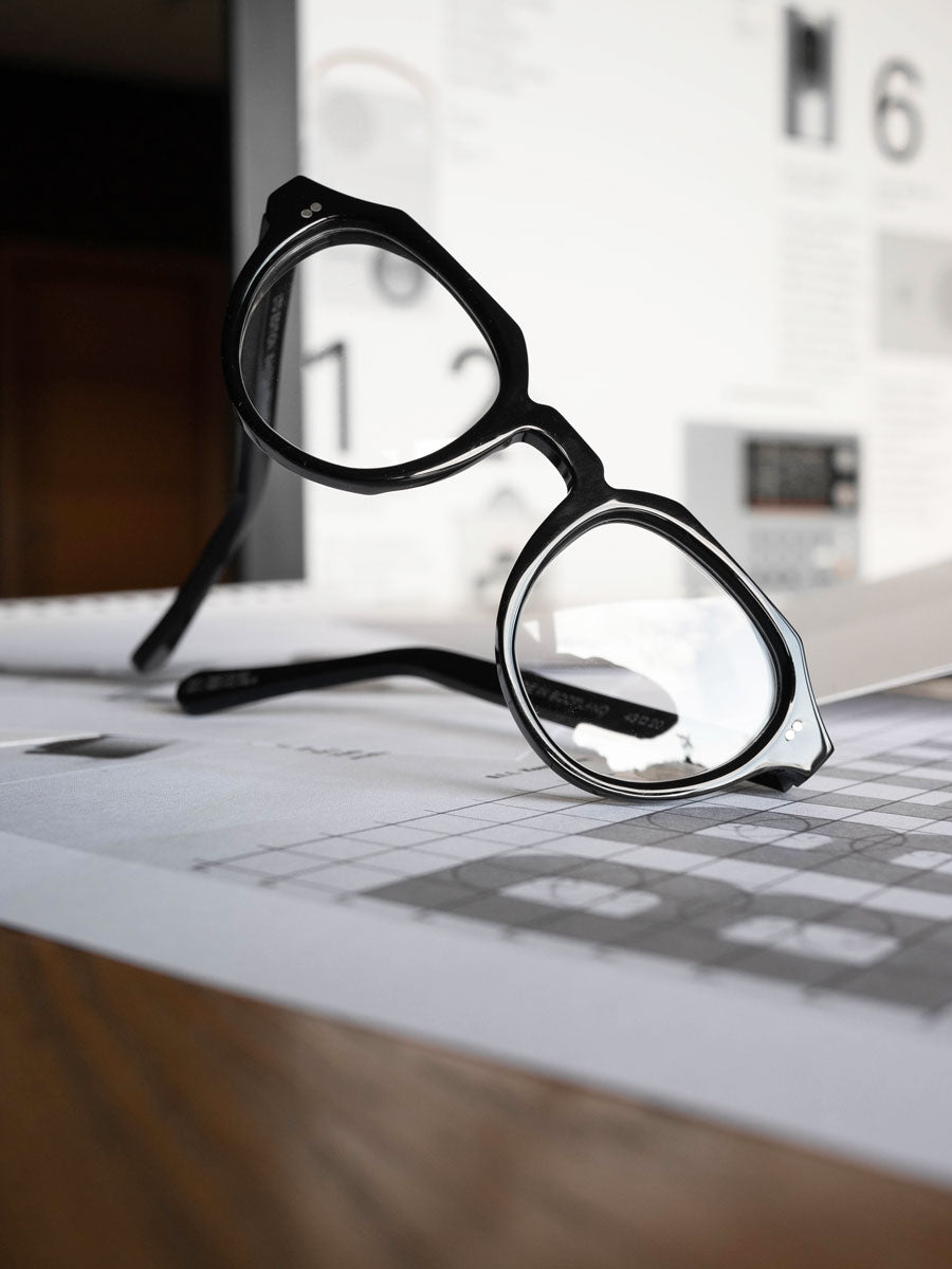 Close view of black designer glasses on their side