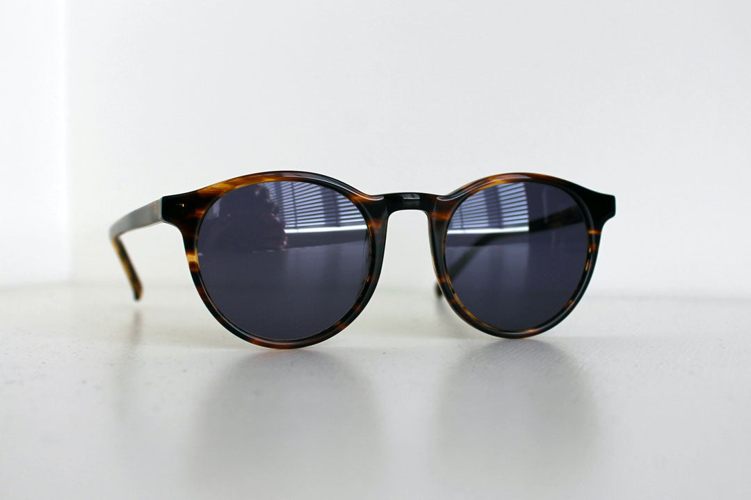 Close view of unbranded round tortoiseshell sunglasses