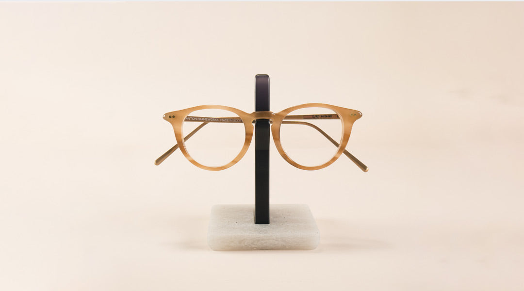 Contemporary eyeglass holder with pair of amber spectacles