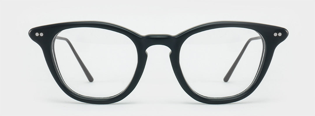 D shaped black spectacle frame with very thin black temples and silver rivets