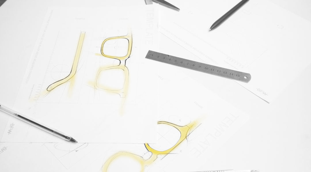 Designing glasses using pens and yellow pastel chalk for ideation