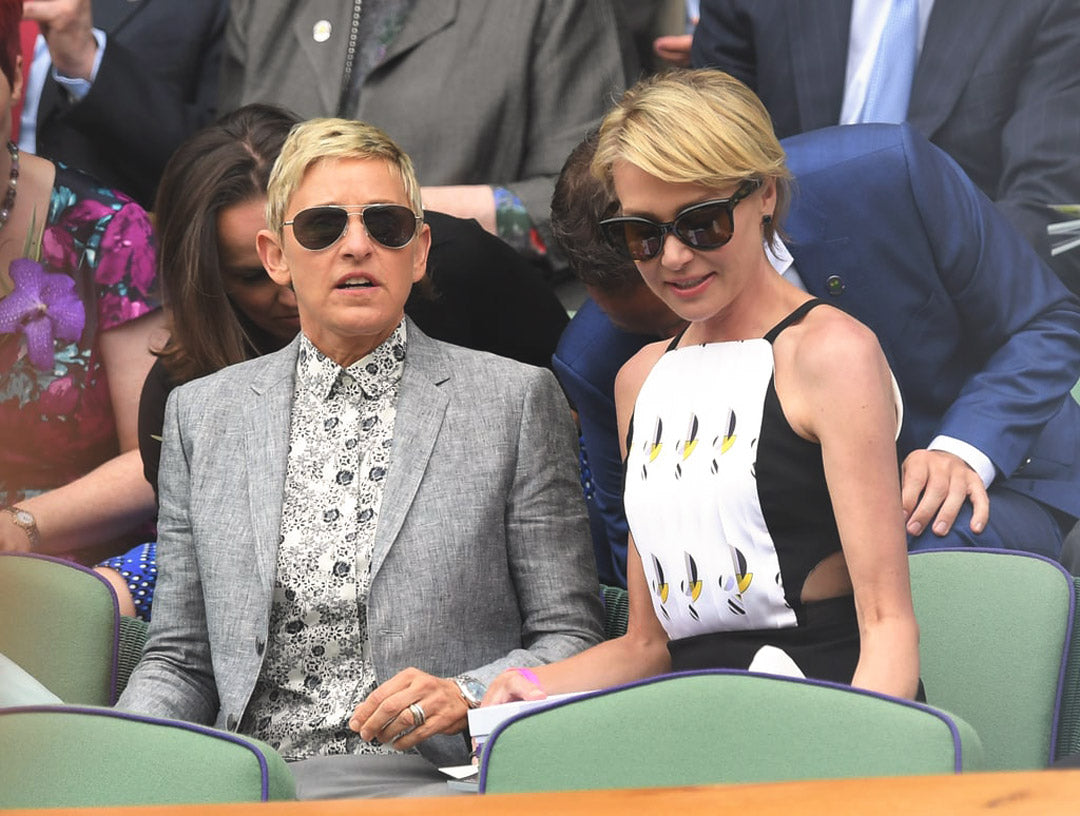 Ellen DeGeneres sitting in the Wimbledon crowd wearing large aviator sunglasses