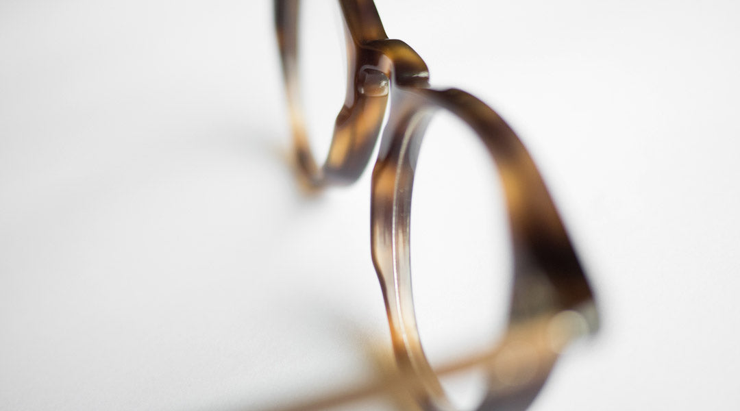 Focused view of a glasses frame with an acetate pad bridge