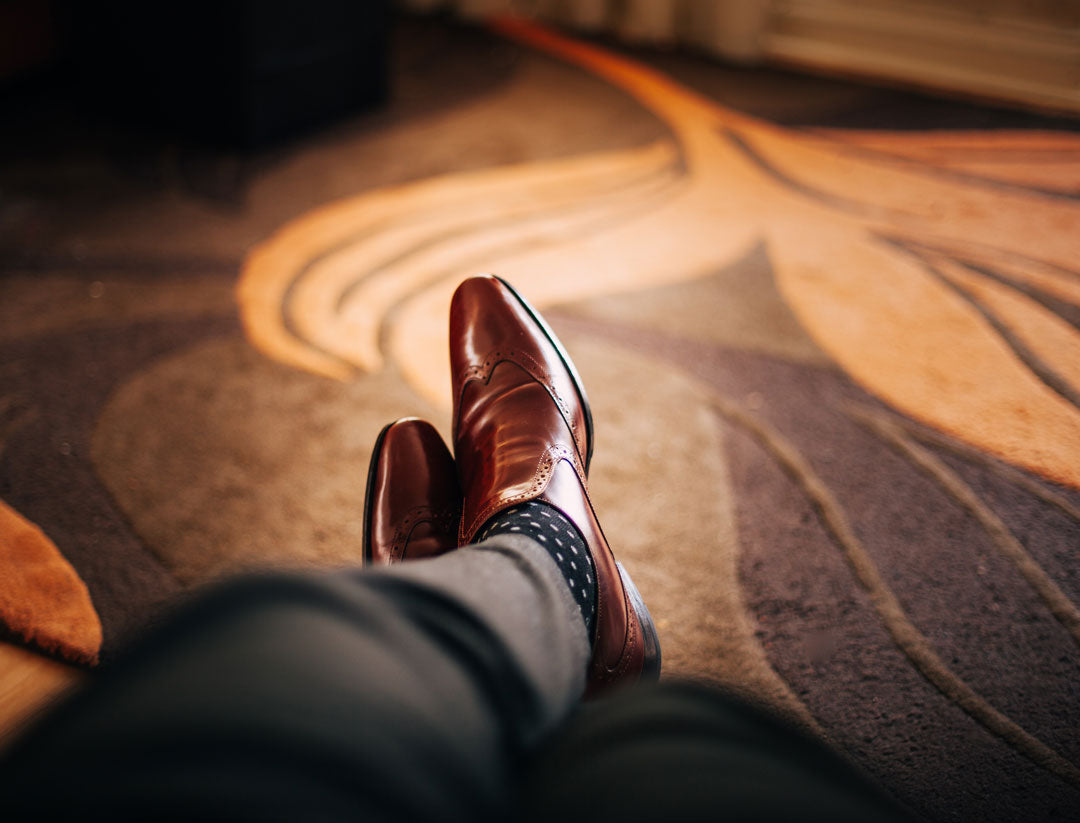 Focused view of men's tan leather shoes