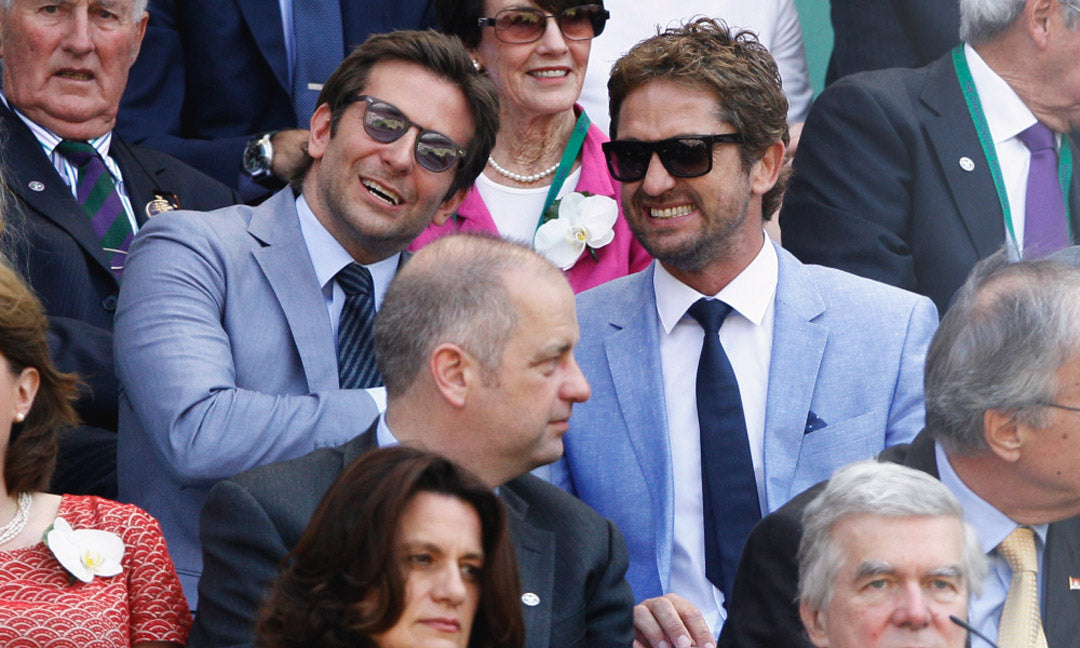 Gerard Butler and Bradley Cooper together in the crowd at Wimbledon wearing suits and sunglasses