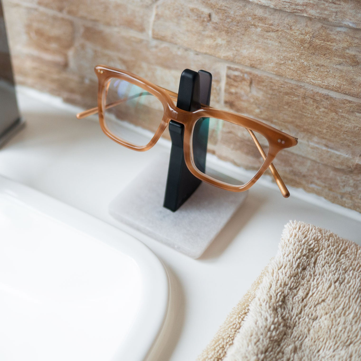 Glasses frame on spectacle stand in bathroom