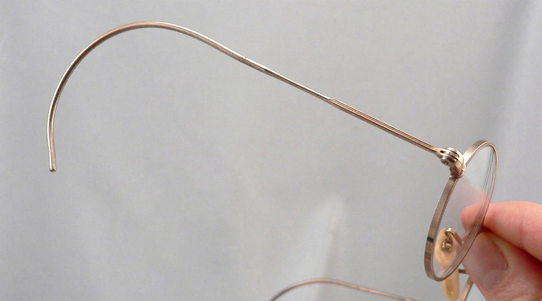 Glasses frame with curl side temples