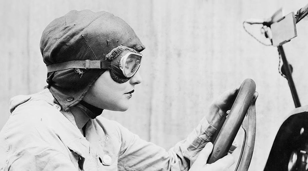 Grescale image of female racing driver wearing goggles