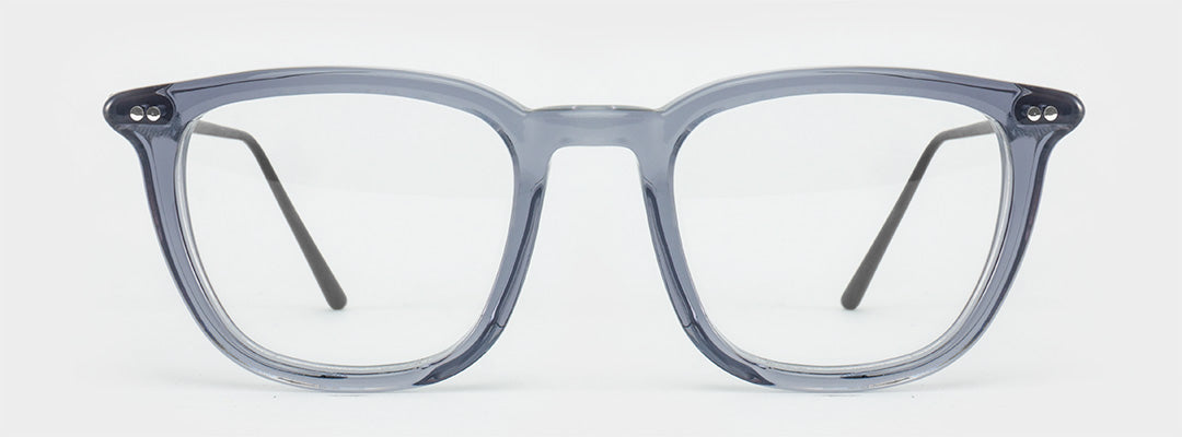 Grey glasses frames with a semi opaque finish and charcoal colored temples