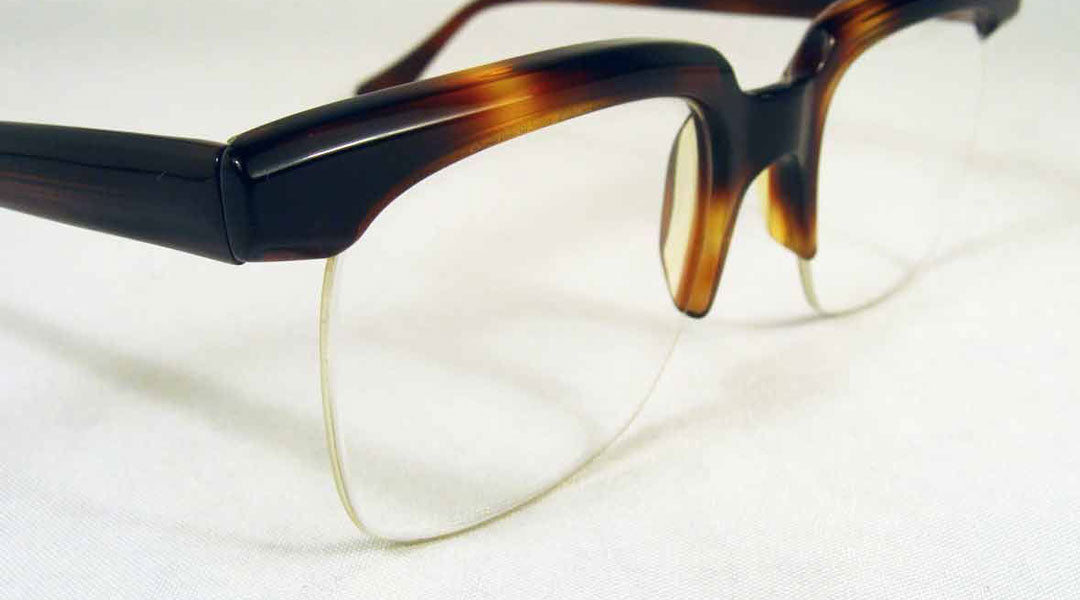 Half rim glasses that use a nylon Supra chord to hold the lenses