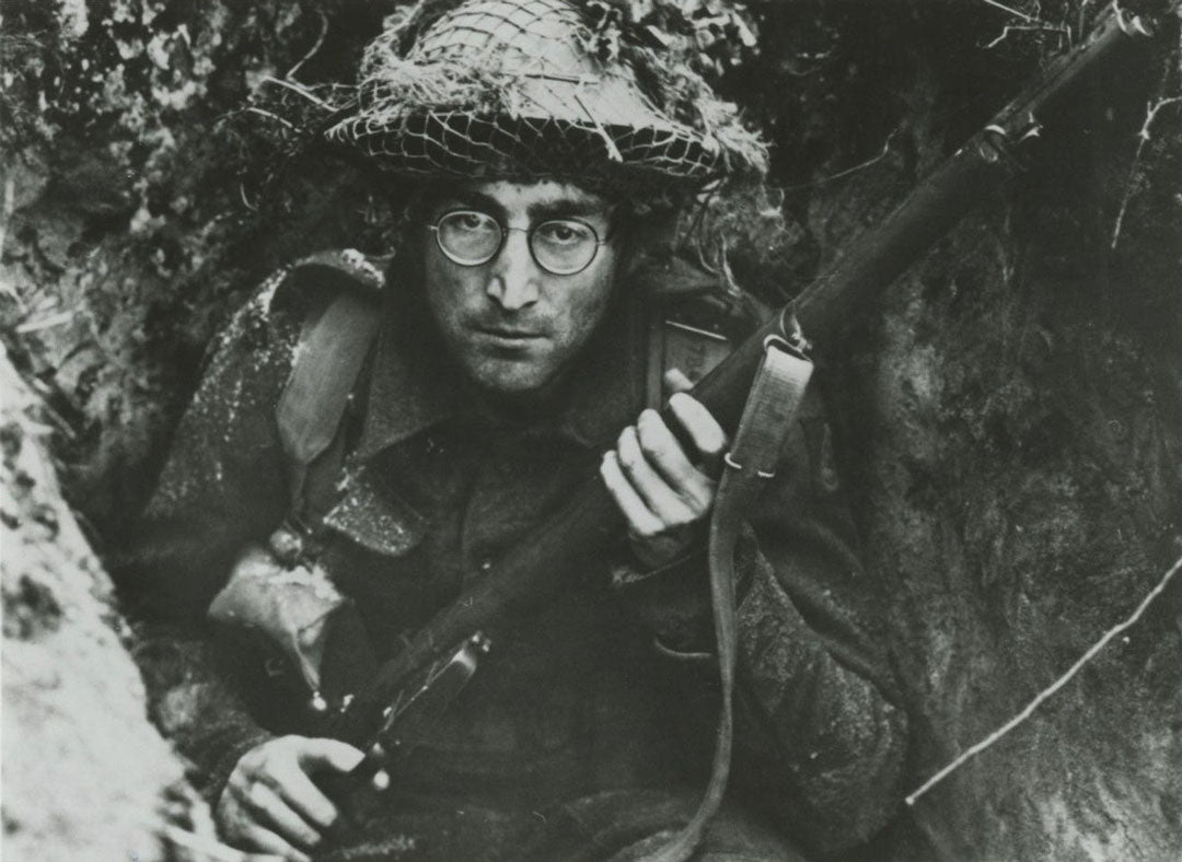 John Lennon in a trench on set for the film How I Won The War black comedy film