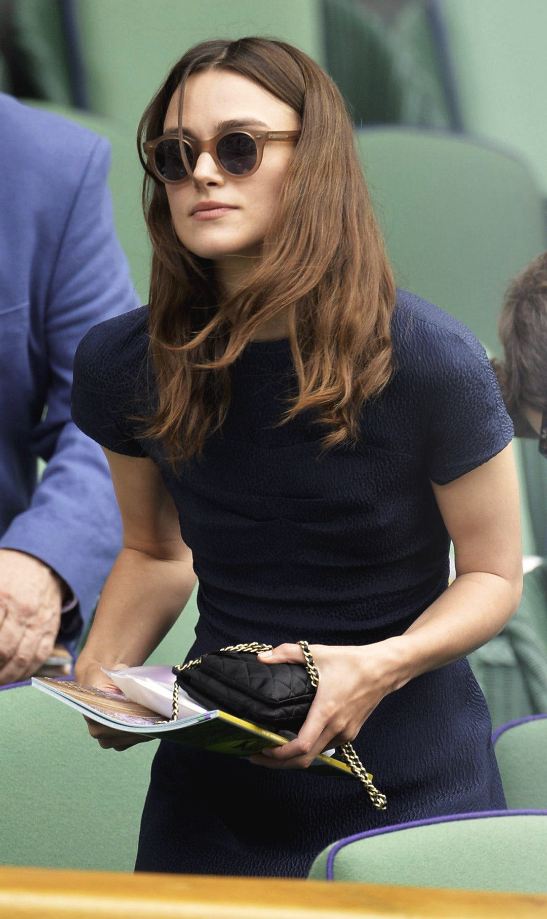 Keira Knightley wears classic round sunglasses at Wimbledon tennis tournament