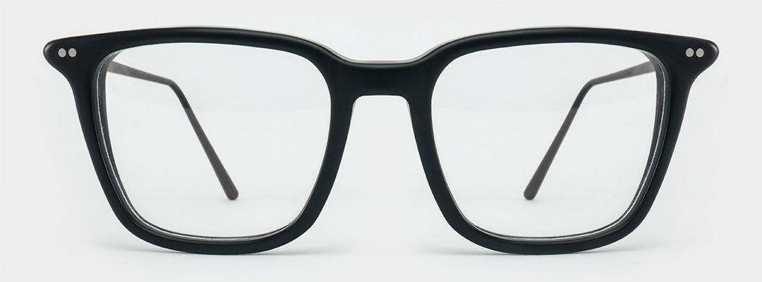 Large black spectacle frame with silver rivets and thin dark legs
