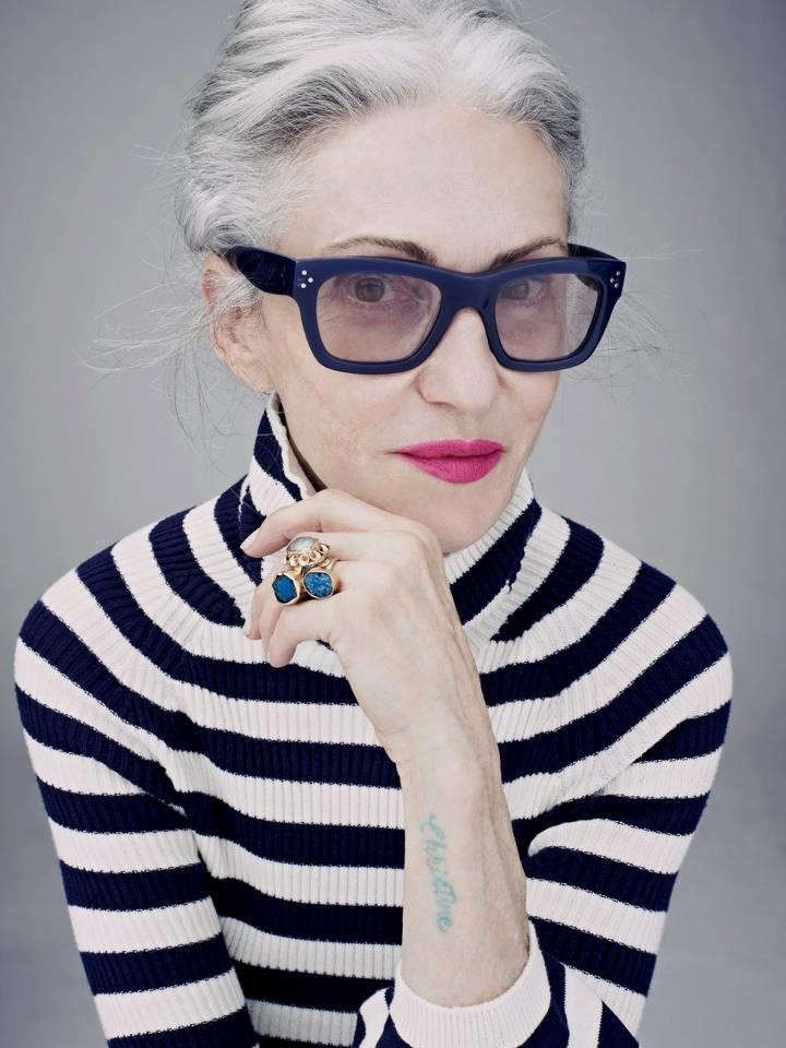 Linda Rodin wearing massive blue glasses frame and striped blue and white jumper