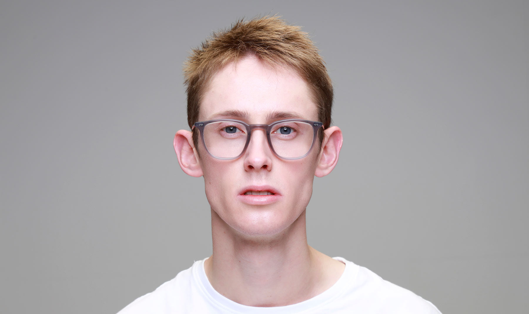 Man-Wearing-Rounded-Square-Grey-Glasses-Frame