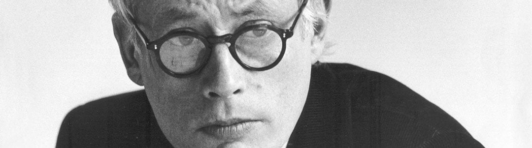 Monochrome image of Dieter Rams wearing his thick rimmed glasses
