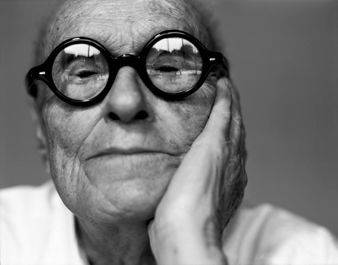 Philip Johnson wearing his thick round spectacles