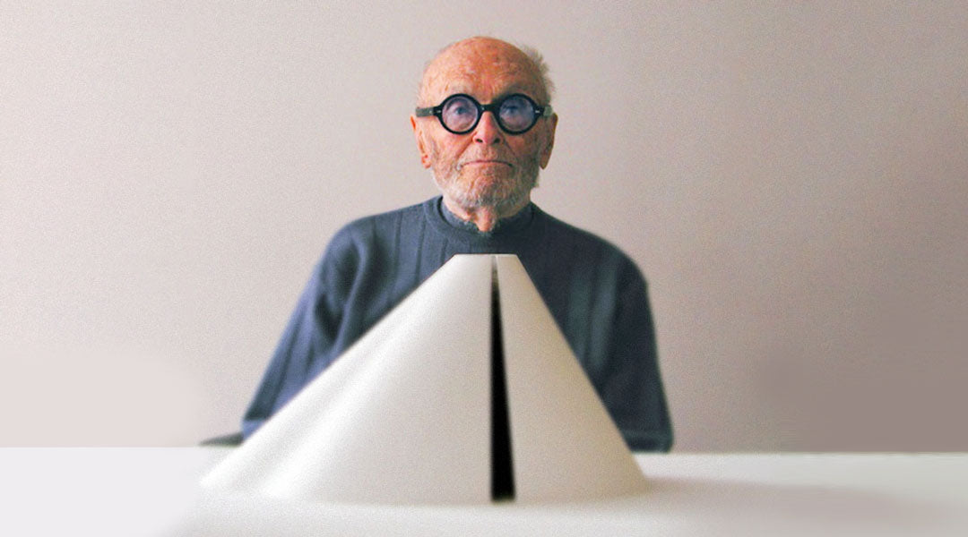 Phillip Johnson sitting in front of a white architectural model