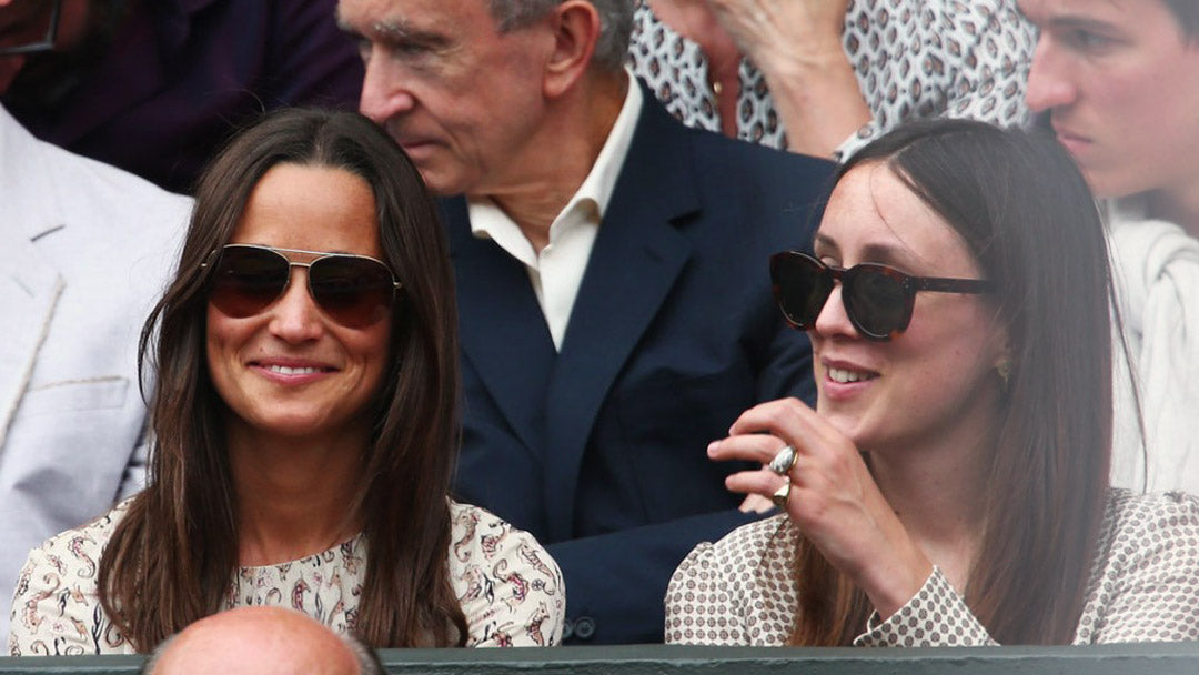 Pippa Middleton enjoying the tennis at Wimbledon smiling directly at viewer