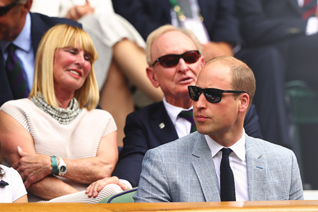Prince William in the Royal Box at Wimbledon wearing suit and sunglasses