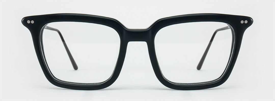 Rectangular black eyeglasses frame with black temples and silver rivets