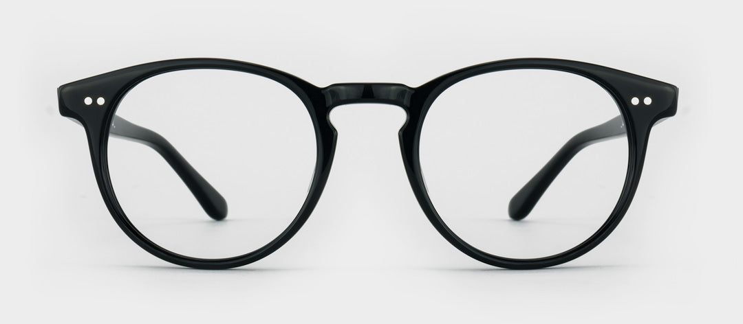 Round black glasses to look younger