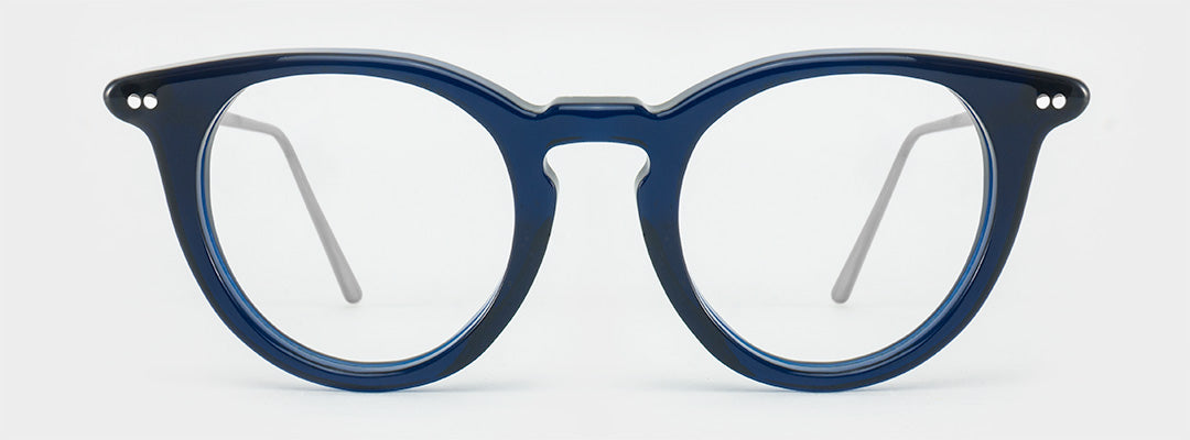 Round blue spectacle frame with silver rivets and silver arms