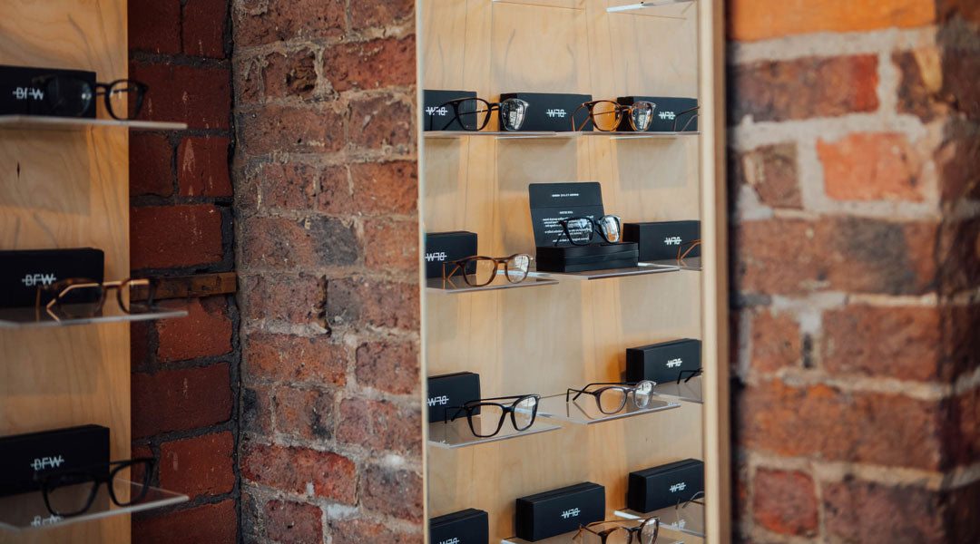 Rows of glasses in optician fitted with demo lenses