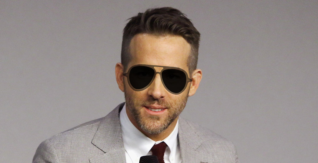 Ryan Reynolds wearing a round grey aviator sunglasses frame