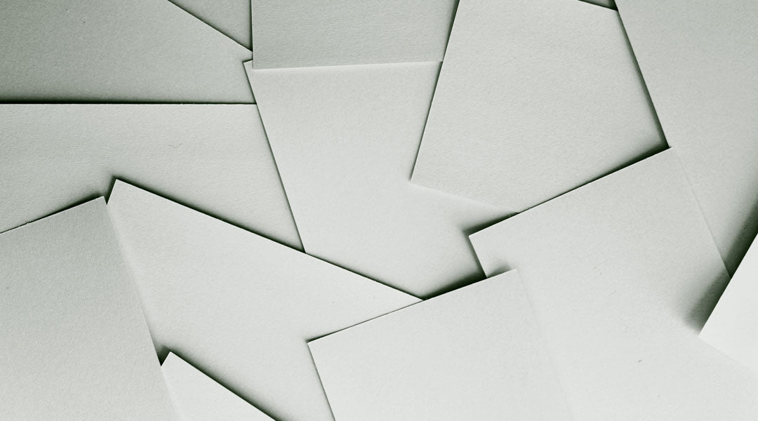 Scattered sheets of blank white paper