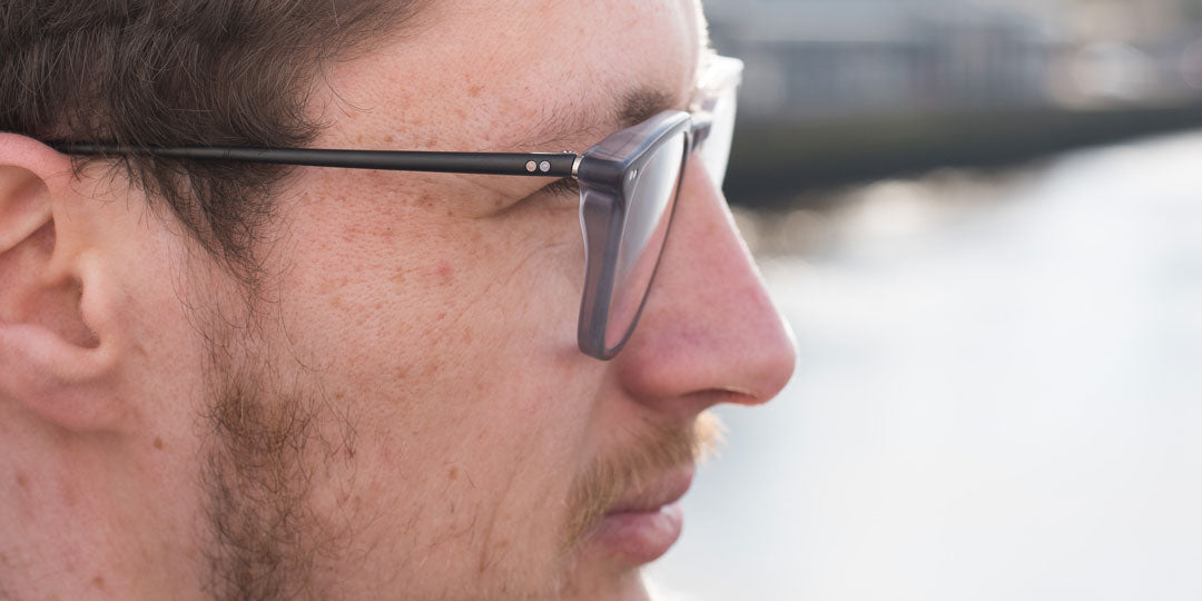 Side view of man wearing grey anti fatigue glasses