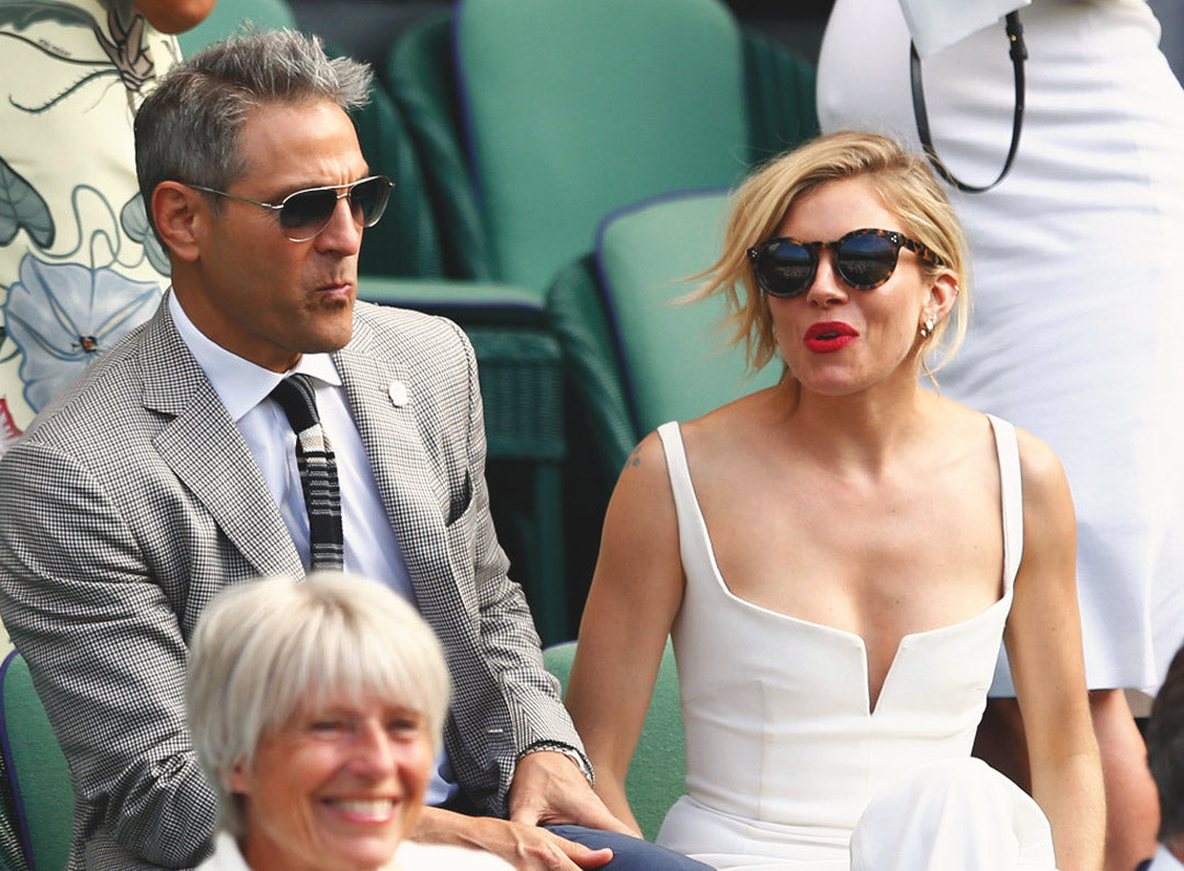Sienna Miller wears round tortoise sunglasses amongst the crowd at Wimbledon tennis stadium